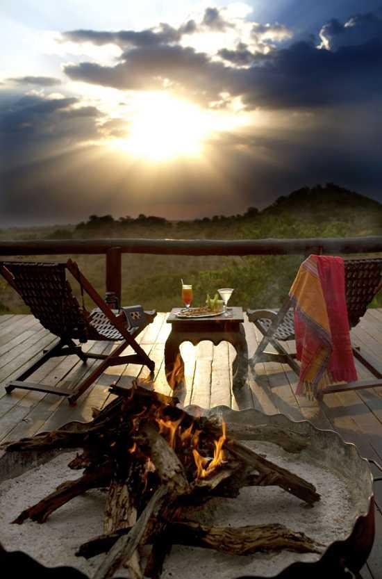Enjoy sitting around the campfire with sundowners at Serengeti Migration Camp