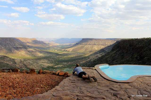 """Chuck enjoying the view of the mountainous area of the Etendeka Plateau from the Grootberg Lodge. Lori described the scenery as """"dizzingly beautiful."""""""