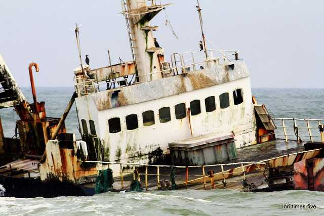"""""""This is an old fishing boat out of Angola. Beached four years ago. Her name is Sela. Now seabirds use her to nest on."""""""