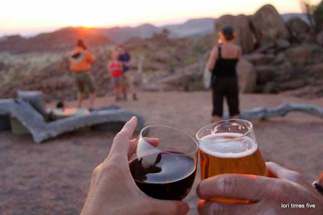 """On reaching the Mowani Mountain Camp, the Grahams were """"greeted with cold wet towels and ice filled drinks and then kindly hurried through reception and up to the viewing rock, so we wouldn't miss sundowners of this kind..."""""""