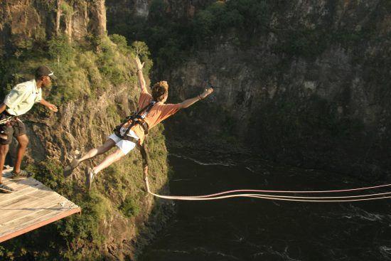 A man bungee jumps at Victoria Falls