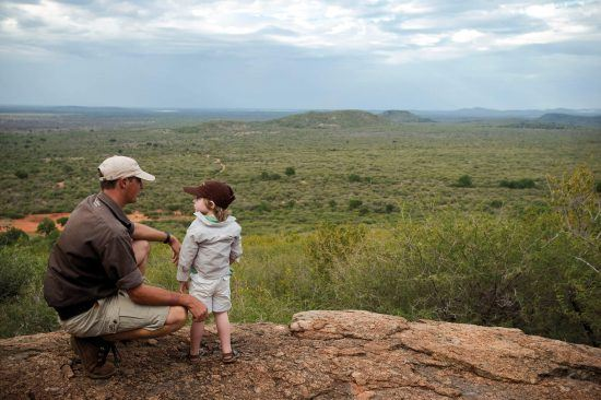 A child learns about the African bush