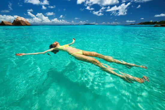 Girl floating in water in Indian Ocean