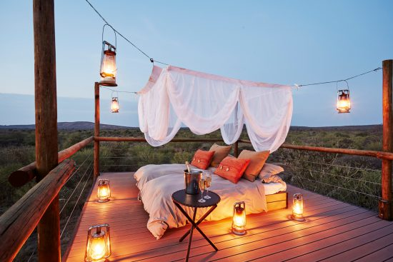 Sleep out deck experiences with lanterns in Africa