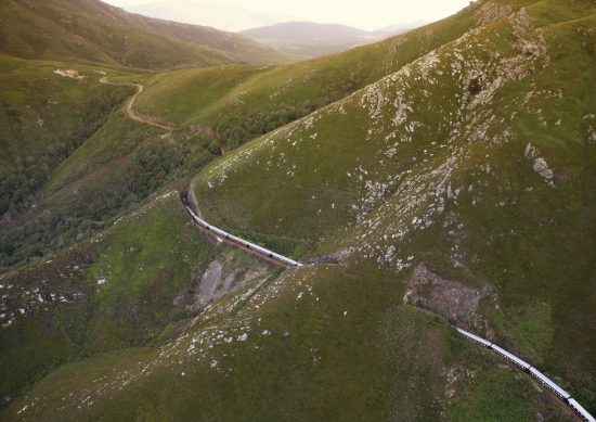 Train going over mountain pass