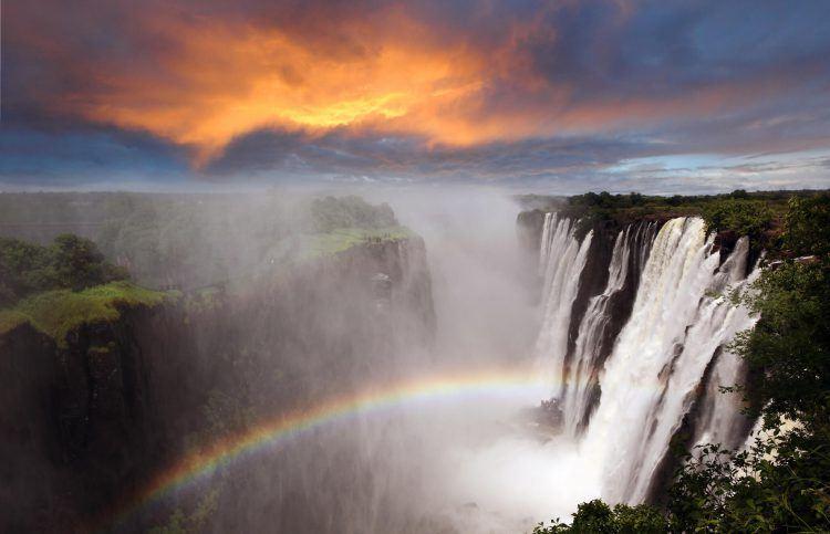 Rainbow over majestic Victoria Falls