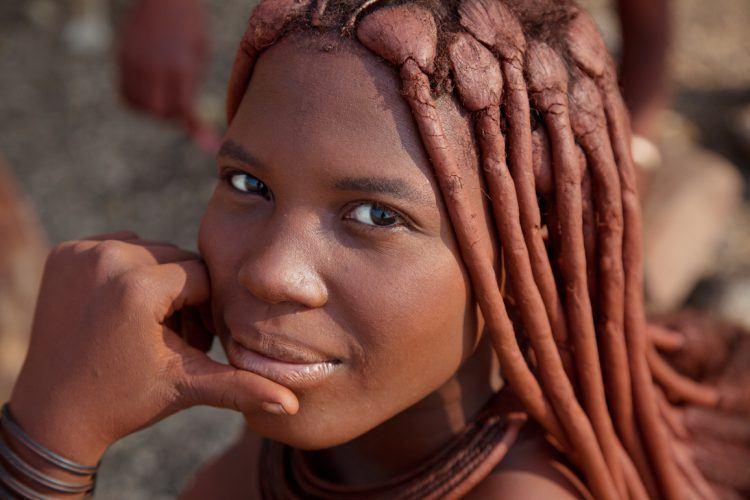 Himba woman smiles at camera