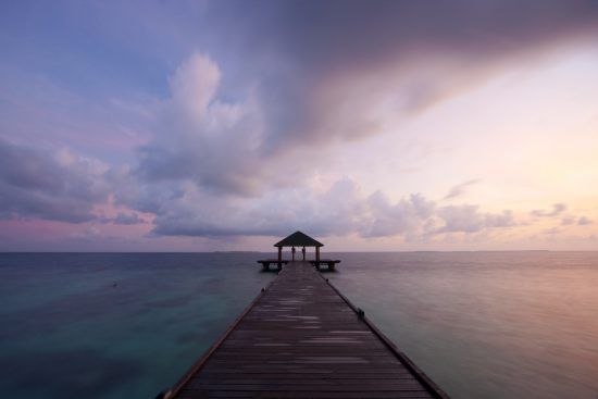 Jetty in the Maldives at sunset