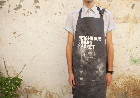 Empreendedor com avental do Neighbourgood's Market