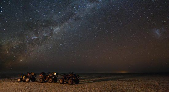 Mythical places in Africa quad bikes under stars in the kalahari