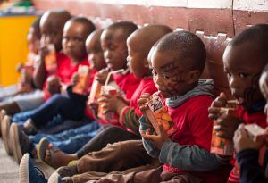 Khumbulani kids eating - feed your soul, feed the nation - Music for Meals Fundraiser