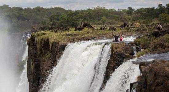 Swimming in Devil's Pool next to Victoria Falls