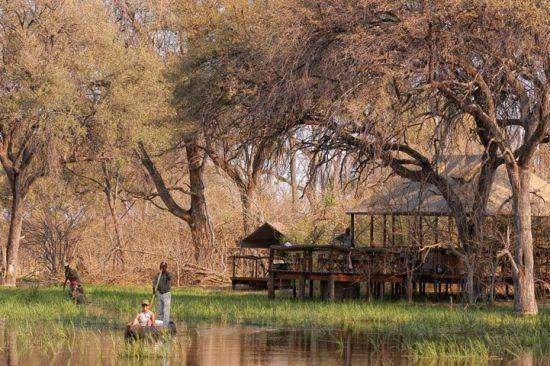 People go canoeing on waters of Khwai Tented Camp