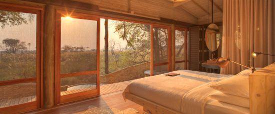 Lieblingsunterkunft von Anja: Ein Schlafzimmer der Sandibe Safari Lodge in warmen Tönen