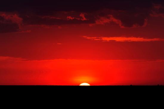 Pôr-do-sol por Clement Kigaru