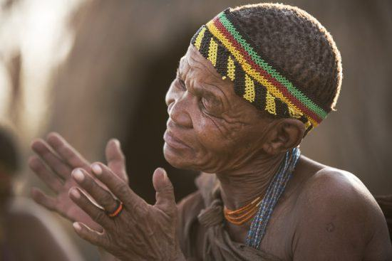 San man in traditional dress in Rhino Africa's Complete Guide