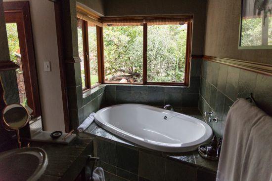Banheira de Owner's Cottage, Camp Ndlovu