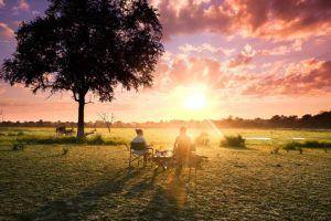 Couple enjoys colorful sunrise in Tanzania
