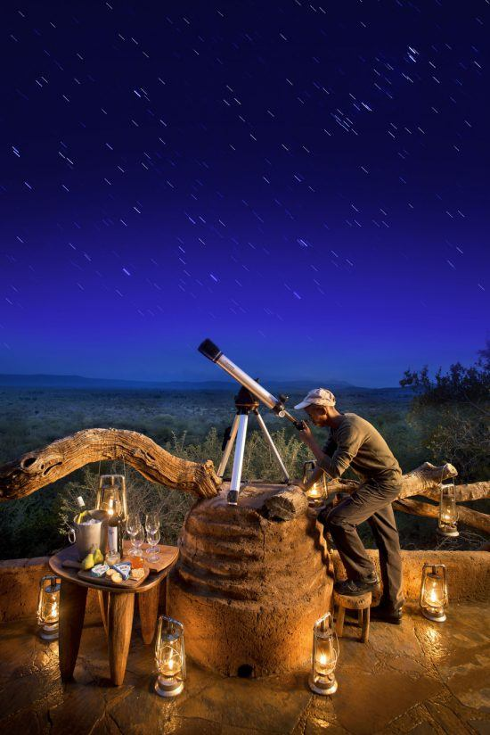 A candle-lit telescope setup at Madikwe Safari Lodge
