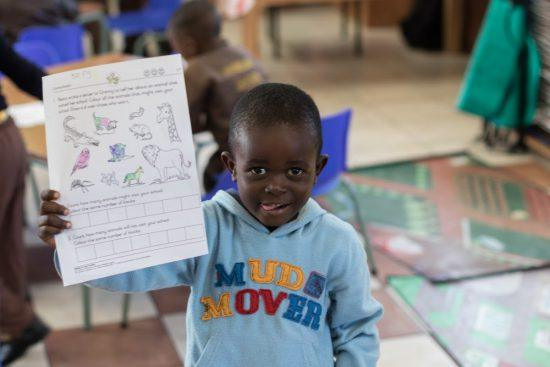 A child at Khumbulani showing his colouring