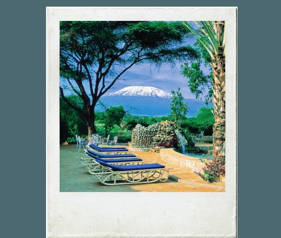 Monte Kilimanjaro visto a partir de área de piscina do Amboseli Sopa Lodge