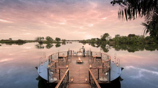 The deck set on the waters surrounding Thorntree River Lodge