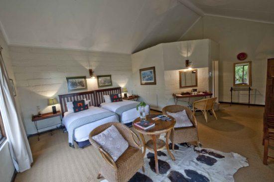 Ein Schlafzimmer des Fugitives Drift Guest House in KwaZulu-Natal