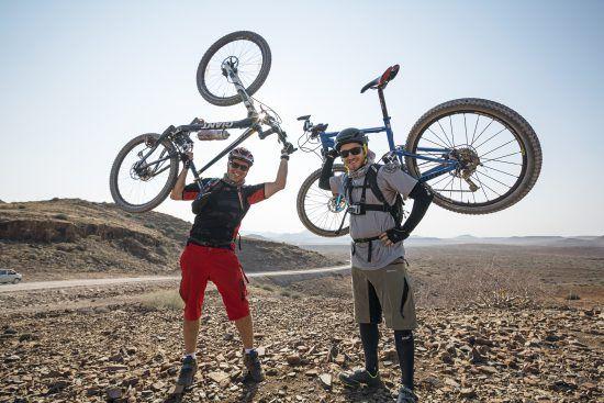 Rhino Africa riders hold their bikes