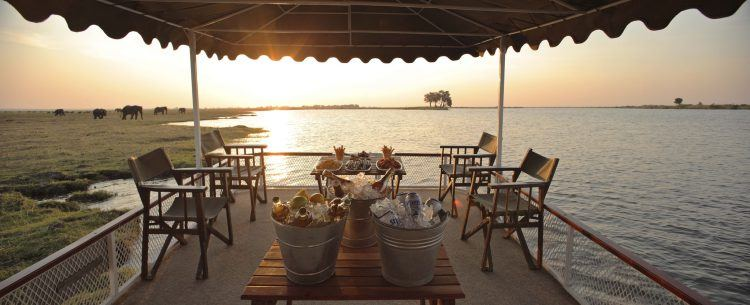 Chobe Under Canvas Camp with view of elephants roaming in Chobe National Park, Botswana