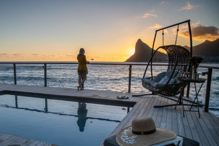 Sunset at the pool at Tintswalo Atlantic in Hout Bay