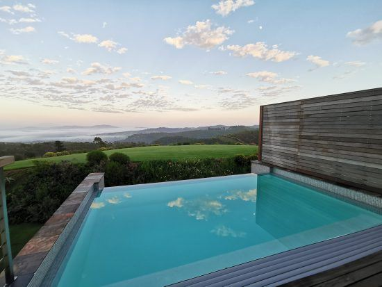 Early morning view over the pool at Delaire Graff