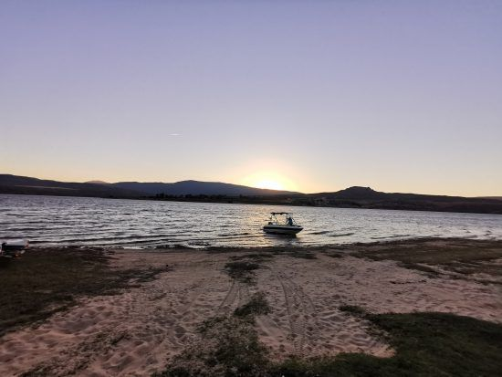 Sunset cruise activity over the Clanwilliam Dam with Cederberg Ridge Wilderness Lodge
