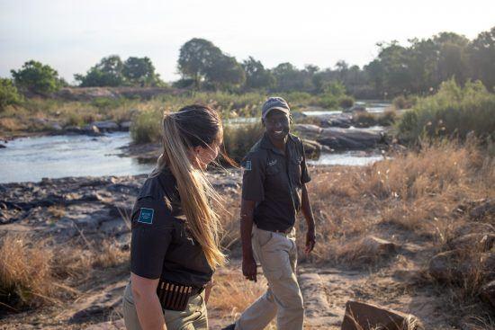 Lee and her tracker on a bush walk near Lion Sands Ivory Lodge