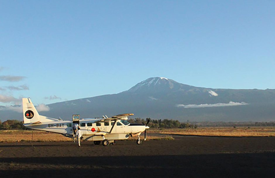 Flying between lodges in East Africa with mount Kilimanjaro in the background