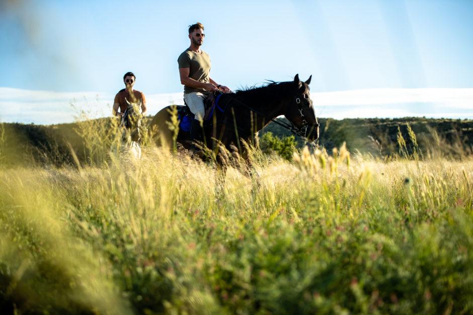 Two men on horseback for horseback riding safari at Tswalu Private Game Reserve