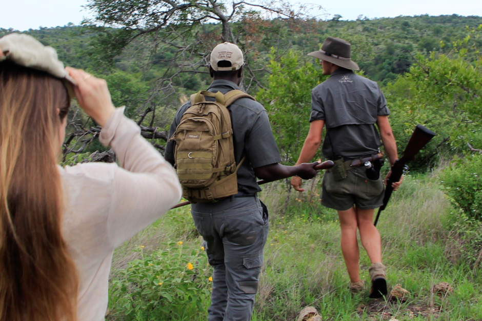 Walking through Big Five wilderness with our Guide, Matt, and Tracker, Casswell